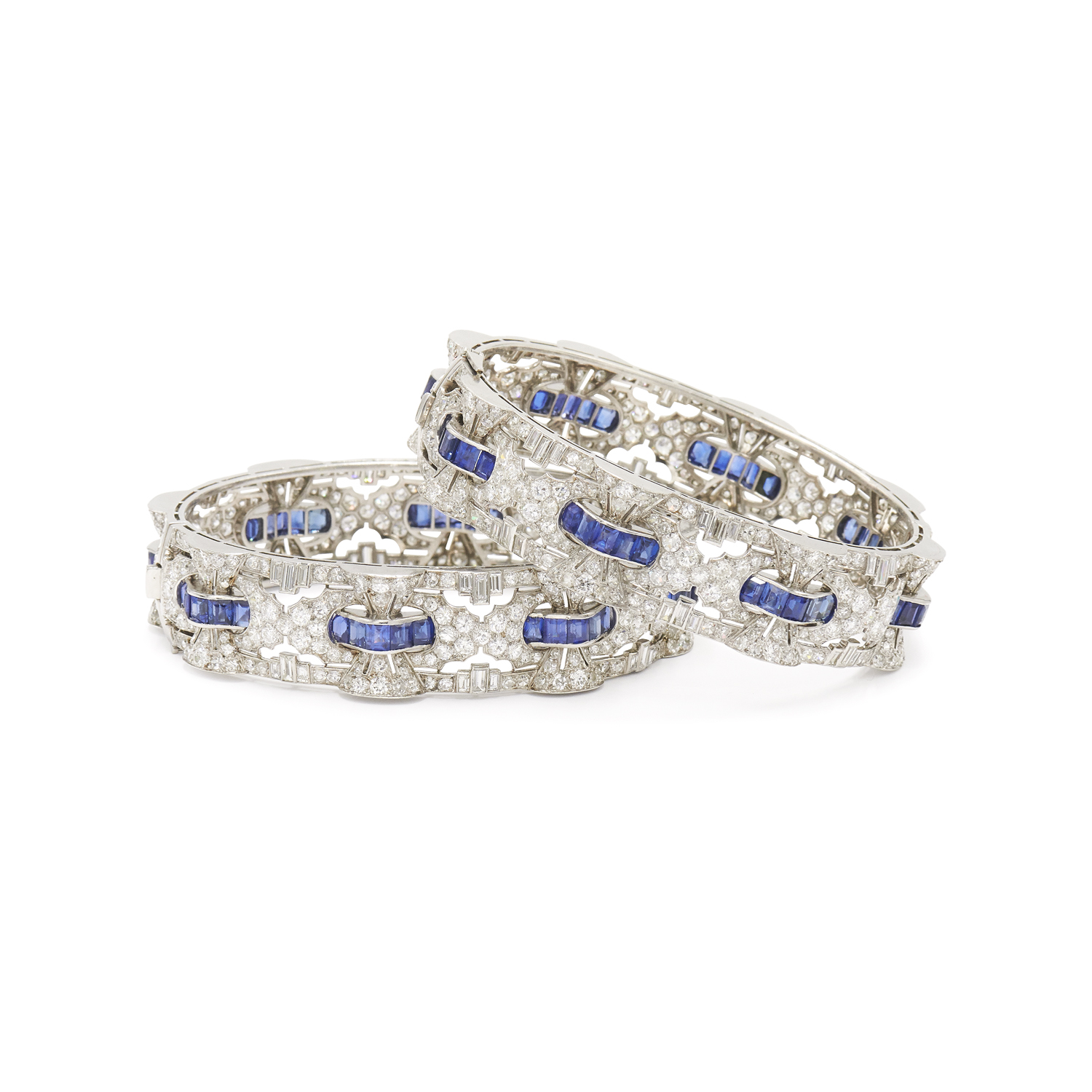 Pair of Art Deco Diamond and Sapphire Bangle Bracelets, Serial FL33934
